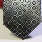 Галстук мужской серого цвета с повторяющимся геометрическим рисунком